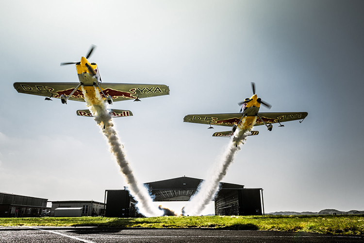 Paul Bonhomme and Steve Jones fly through a hangar during Red Bull Barnstorming photoshooting in Llandbedr, Wales, UK, on April the 09th, 2015