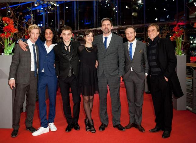 """Director Sebastian Schipper (3rd R) and cast members, Max Mauff (L-R), Burak Yigit, Franz Rogowski, Laia Costa, Frederick Lau and Andre Hennicke, arrive on the red carpet for the screening of the in competition movie """"Victoria"""" at the 65th Berlinale International Film Festival in Berlin February 7, 2015. REUTERS/Stefanie Loos"""